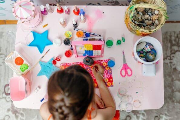 girl-painting-rocks